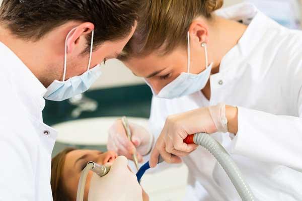 two dentists performing sleep dentistry