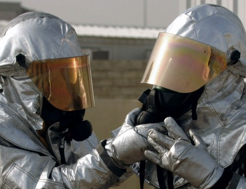 two people in hazmats suits, probably because of bad breath